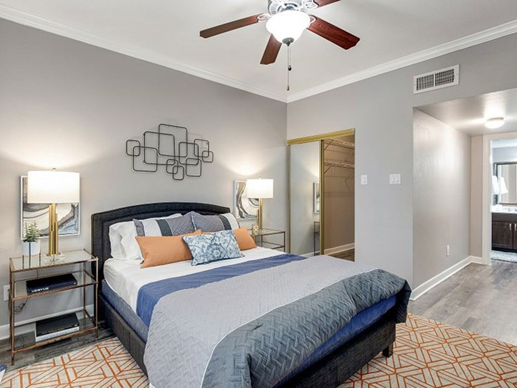 Master Bedroom With Closet and Ceiling Fan at The Village at Bellaire Apartments in Houston, Texas