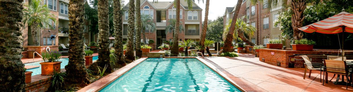 Swimming Pool View at The Village at Bellaire Apartments in Houston, Texas