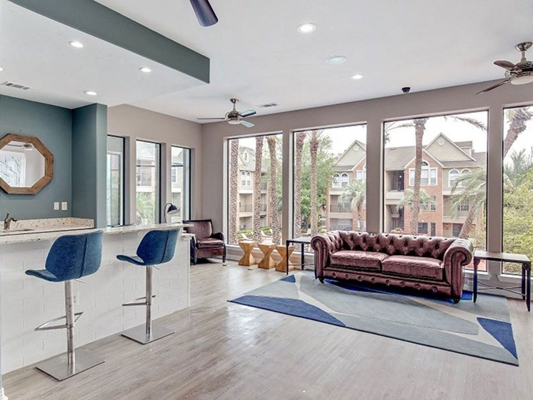 Living Room Layout With Large Windows at The Village at Bellaire Apartments in Houston, Texas