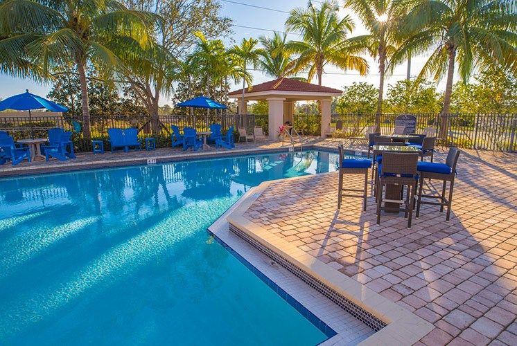 Refreshing swimming pool with relaxing sun deck at Casa Brera at Toscana Isle Apartments, Lake Worth, FL 33463