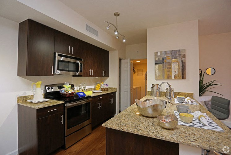 Gorgeous Kitchens Complete with Designer Finishes, Modern Appliances, Granite Countertops and Large Island at Casa Brera at Toscana Isle Apartments, Lake Worth, FL 33463