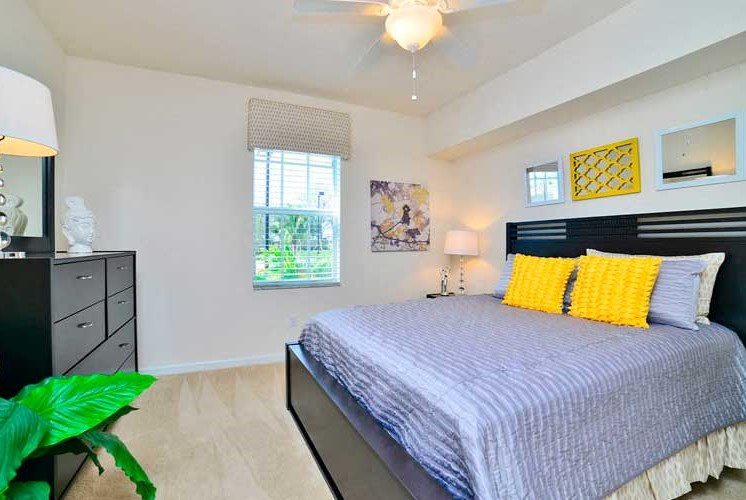 Master Bedroom Feels Large and Spacious with Impressive High Ceilings and Large Walk-In Closets at Casa Brera at Toscana Isle Apartments, Lake Worth, FL 33463