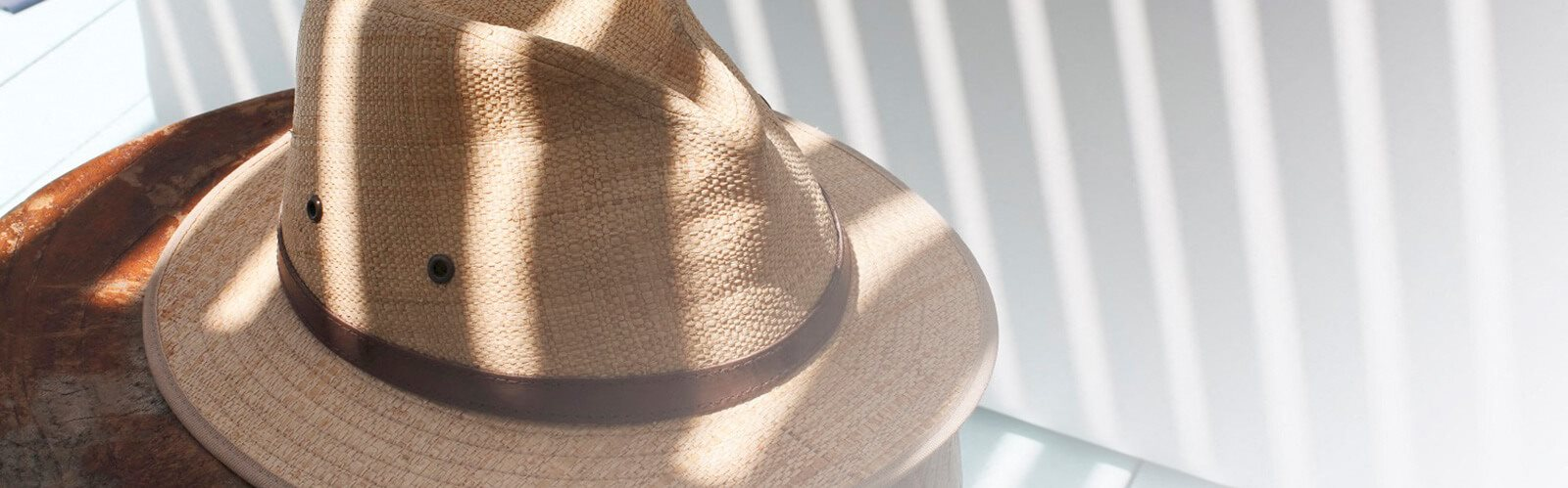 Beach Hat with Fence Lifestyle Image for Casa Brera at Toscana Isle Apartments, Lake Worth, FL 33463
