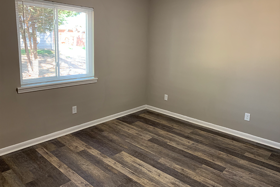 Bedroom at Wynwood Place Estates Apartments with Plank Flooring Renovated For Rent in Raleigh NC