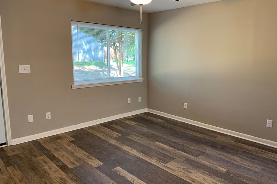 Wynwood Place Estates Living Room with Plank Flooring Renovated Apartment For Rent Downtown Raleigh