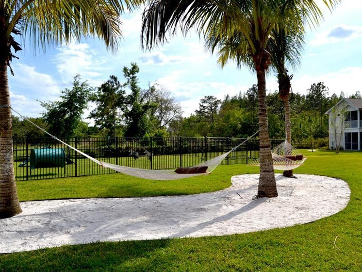 Outdoor Relaxing Area with Swings at Altis at Grand Cypress, Lutz, Florida