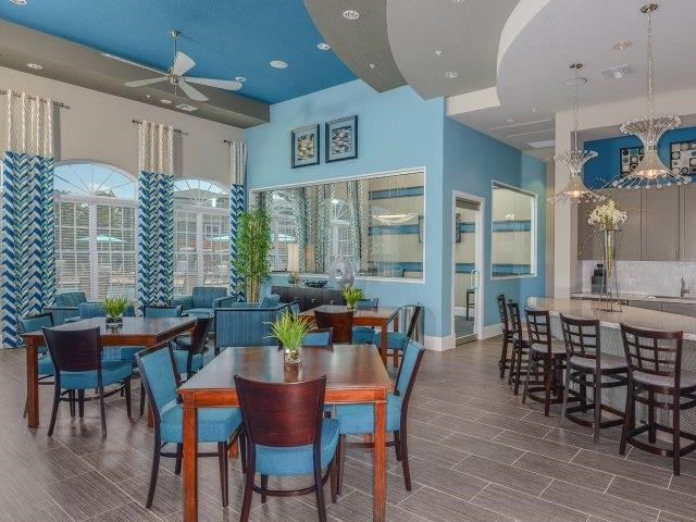 Clubhouse with TV, Fireplace, and Kitchen at Reserves at Alafaya, Orlando, 32828