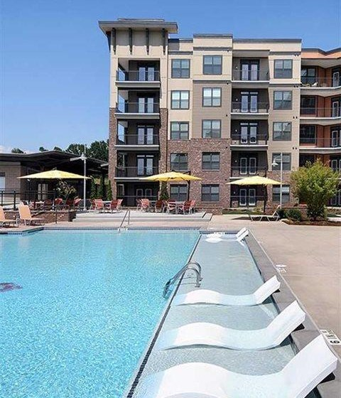 Resort Inspired Pool with Relaxing Tanning Ledge at The Views at Coolray Field, Lawrenceville, 30043