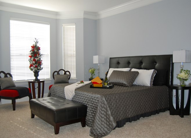 Bedroom with Carpeting and Crown Molding at Fountains at Champions in Houston, Texas 77069