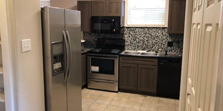 Fully-Equipped Kitchen with Stainless Steel Appliances, Custom Cabinets and Granite Countertops, at Fountains at Champions in Houston, Texas 77069