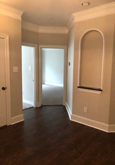 Open Hallways with Hardwood Flooring at Fountains at Champions Apartments in Houston, Texas 77069
