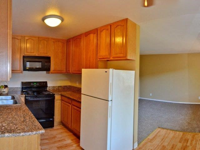 Black Kitchen Appliances at Marina Crescent Apartments, California