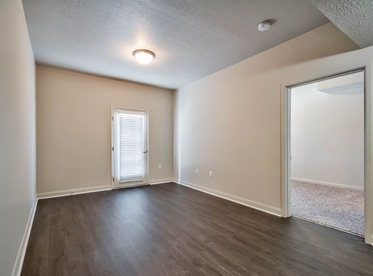 empty bedroom with plank flooring