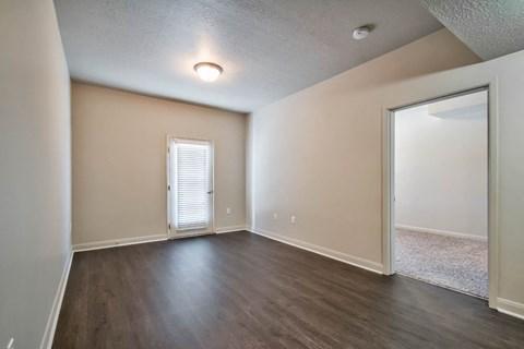 empty bedroom with plank flooring