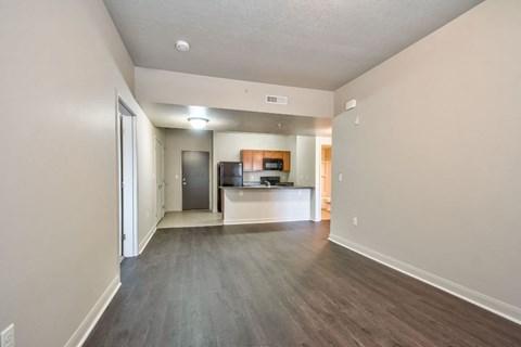 empty living room with plan flooring