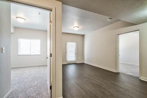 empty bedroom hallway and living room