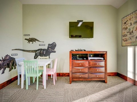 room with kids table and dresser