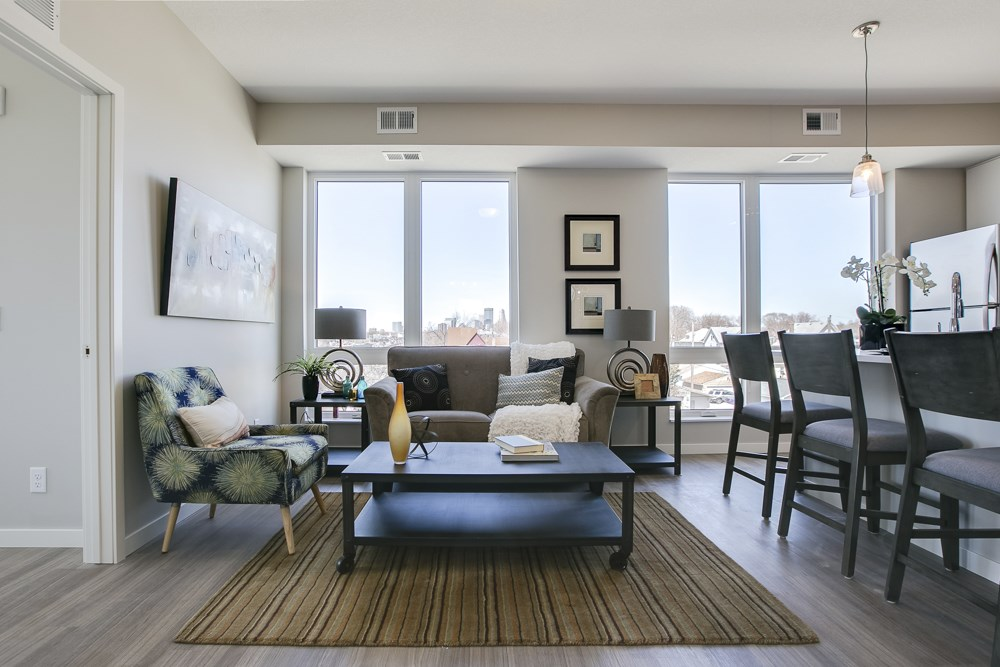 Living room with view of downtown through large windows at The Central apartments near downtown Minneapolis MN 55408