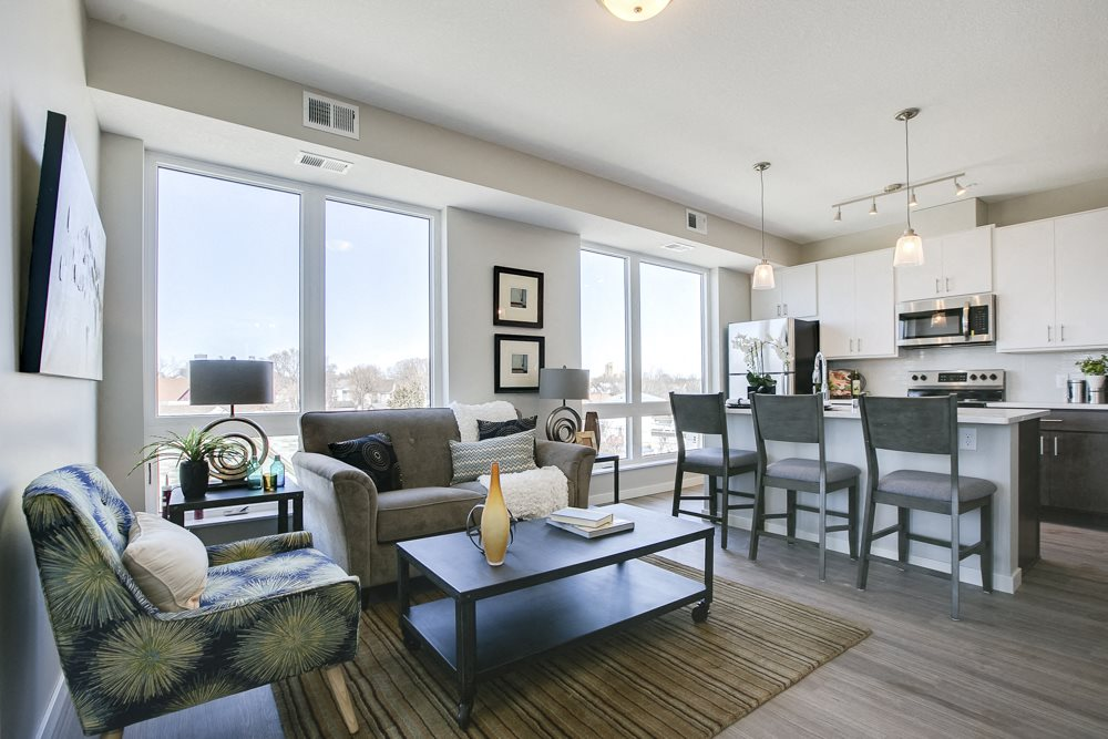 Open floor plan with white cabinetry and hardwood-style floors at The Central apartments near downtown Minneapolis MN 55408