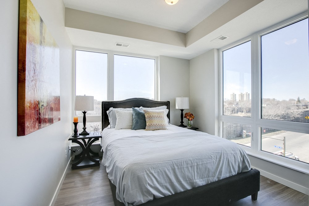 Bedroom with large windows and high ceilings at The Central apartments near downtown Minneapolis MN 55408