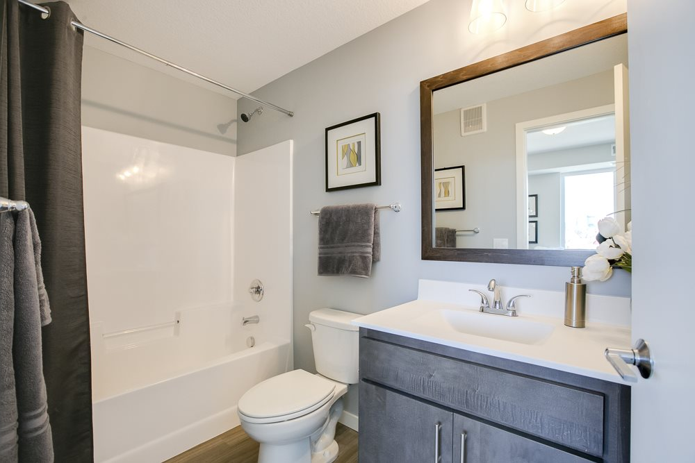 Bathroom with tub and quartz countertops at The Central apartments near downtown Minneapolis MN 55408
