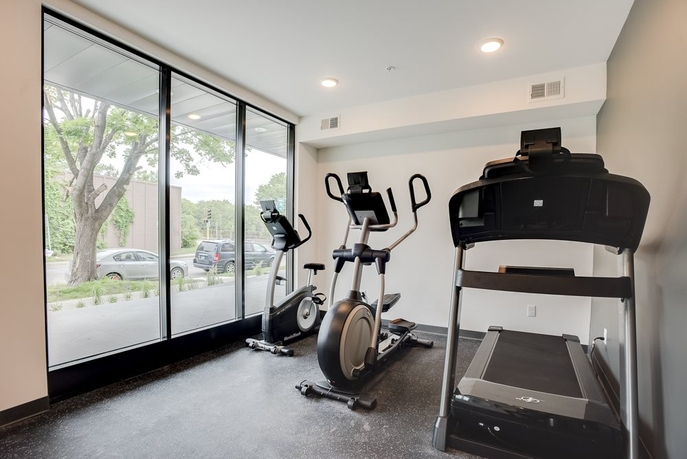 Workout gym with cardio equipment at The Central apartments near downtown Minneapolis MN 55408