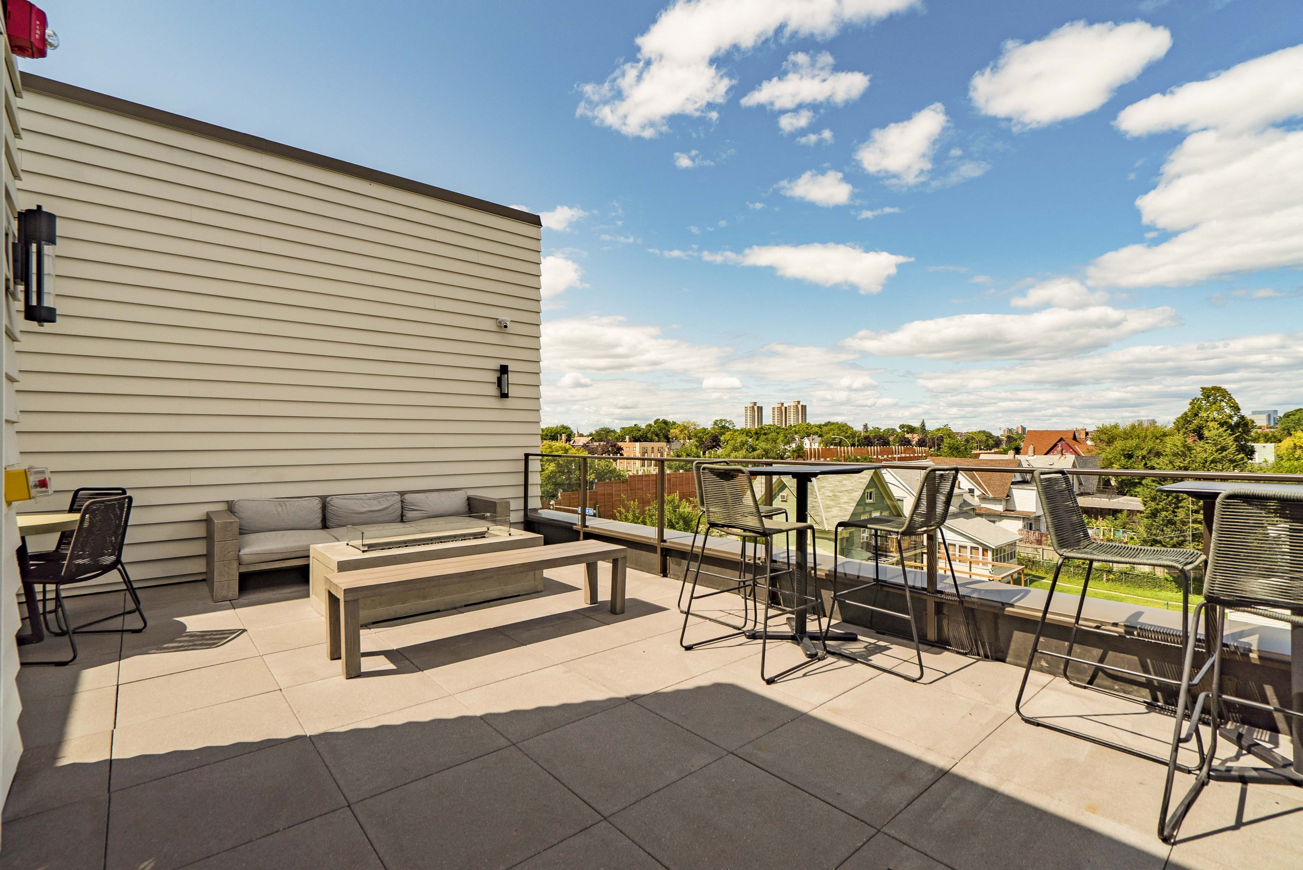 Rooftop patio and outdoor firepit at The Central apartments near downtown Minneapolis MN 55408