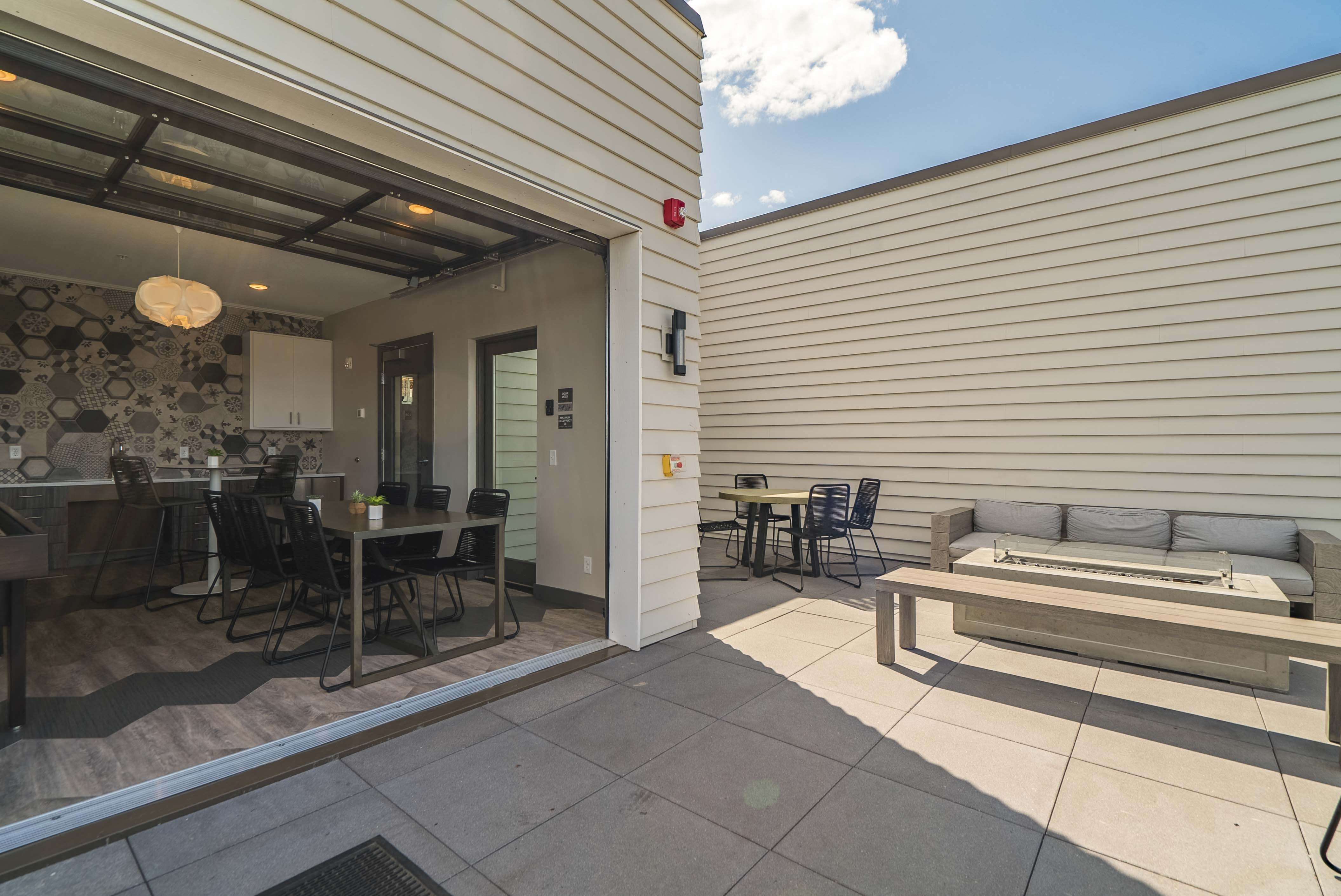 Rooftop deck and outdoor firepit at The Central apartments near downtown Minneapolis MN 55408