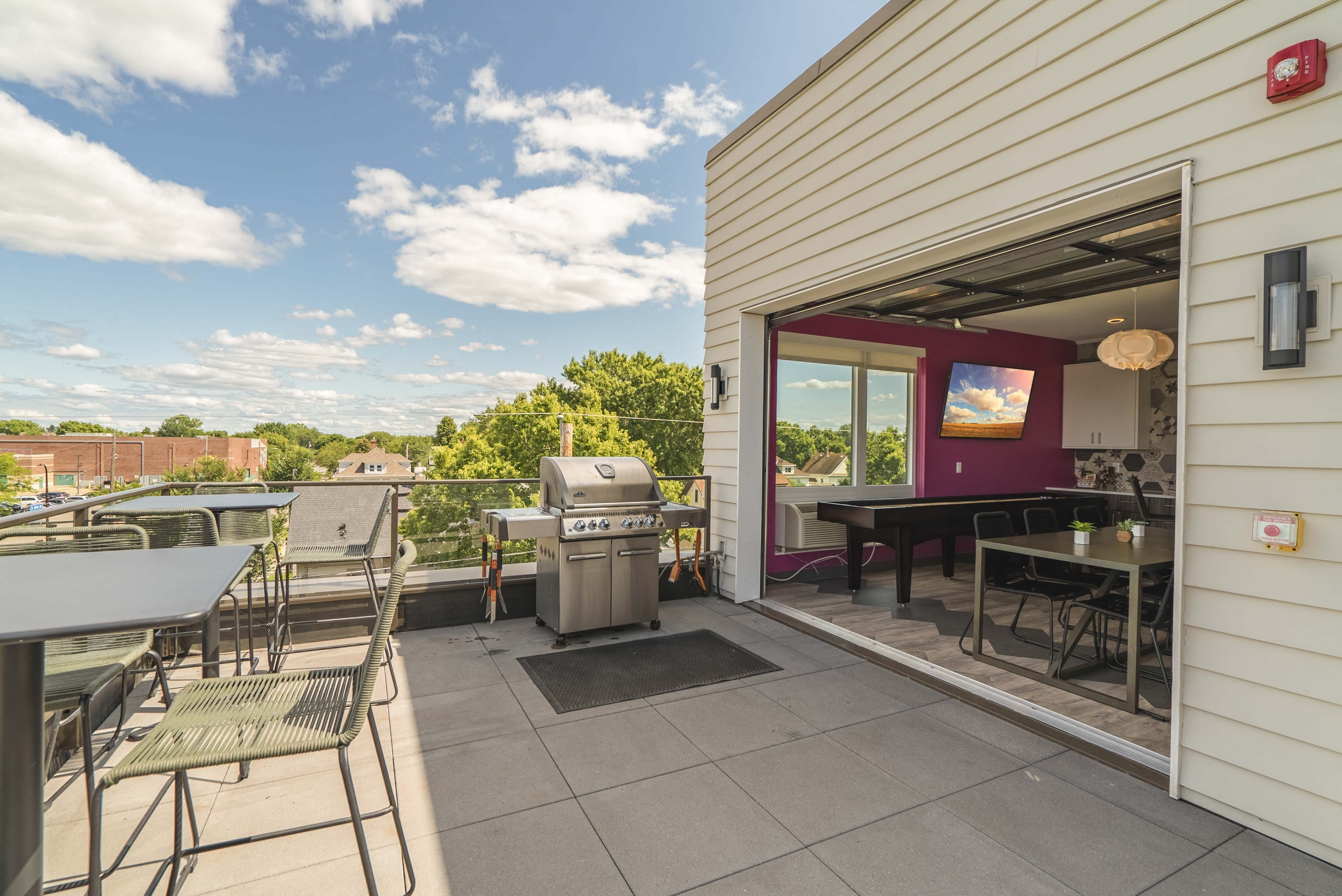 Rooftop community room opens to the patio and deck at The Central apartments near downtown Minneapolis MN 55408