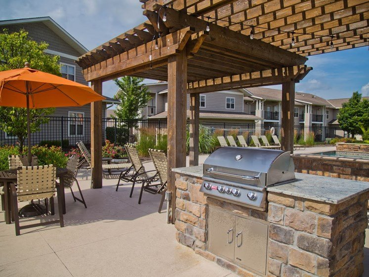 Outdoor Grill With Intimate Seating Area at The Manor Homes of Eagle Glen, Raymore, Missouri