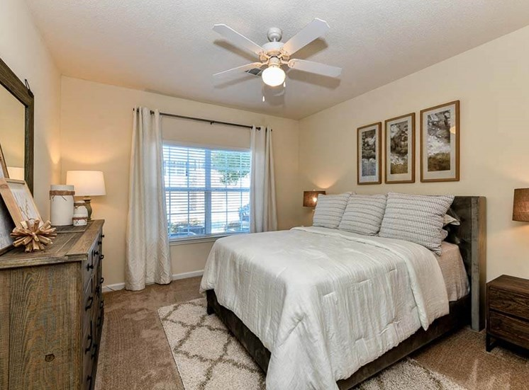 Spacious Bedroom with Large Walk-In Closets & Ceiling Fans at Legends at Charleston Park Apartments, North Charleston, SC, 29420