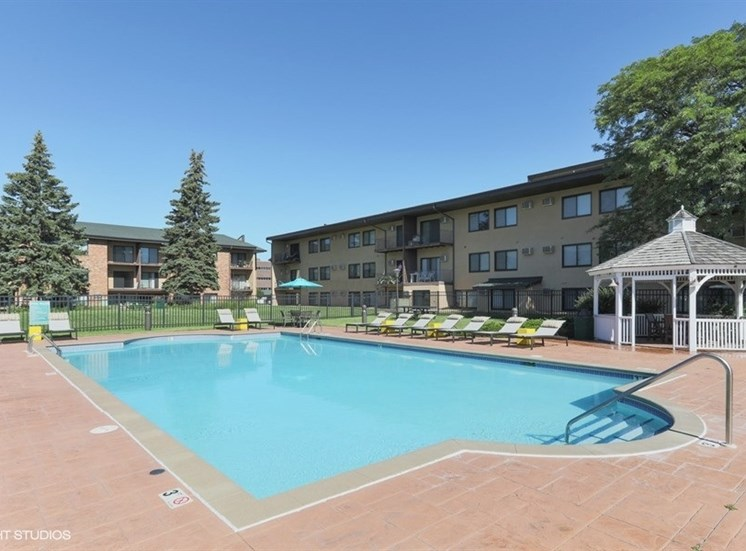 Outdoor pool with gazebo to enjoy at Equinox Apartments