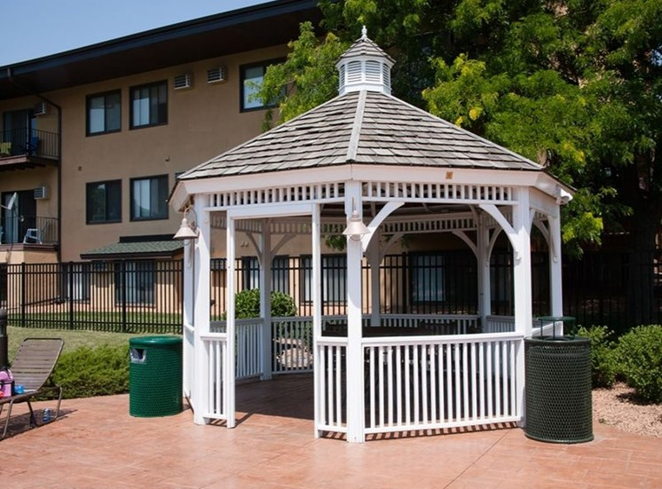 Gazebo by the pool at Equinox Apartments