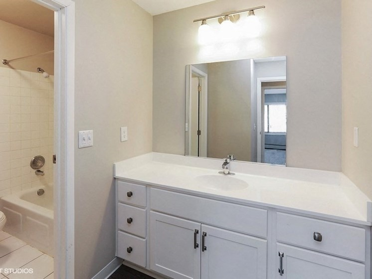 Bathroom with large vanity area at Equinox Apartments