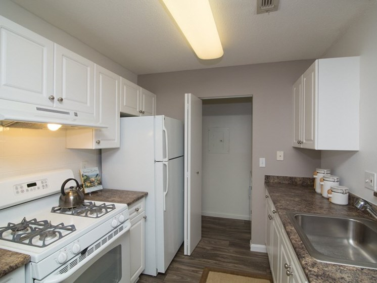 Galley Kitchen with White Cabinets at Town Walk at Hamden Hills, Hamden, CT, 06518