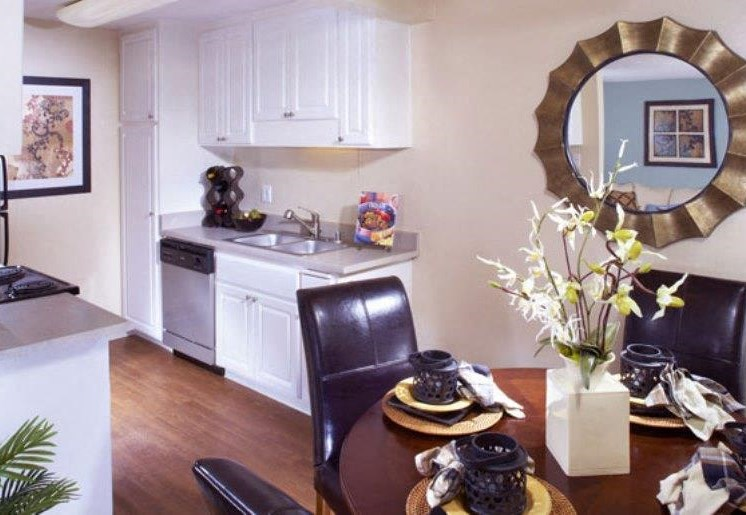 Furnished dining room model and kitchen