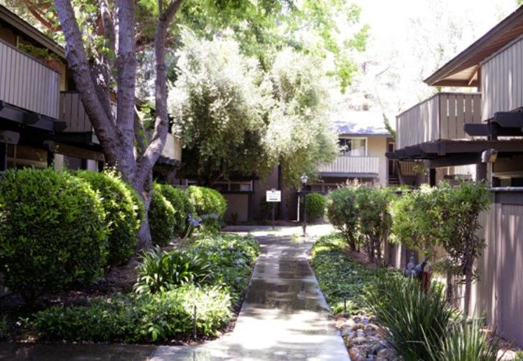 Community walkway with lush landscaping