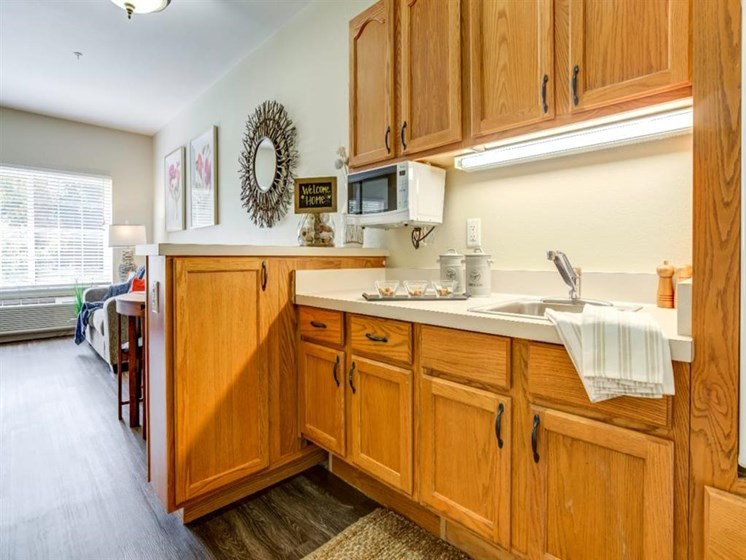 Kitchen With Custom Cabinetry at Westmont of Fresno, California, 93720