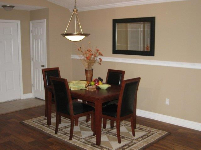 Sophisticated Dining Area With Modern Lighting at Lullwater at Calumet, Georgia, 30263