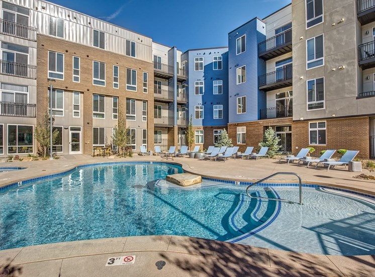 Lone Tree Apartments - Aspect Lone Tree Sparkling Pool with Spa and Lounge Chairs