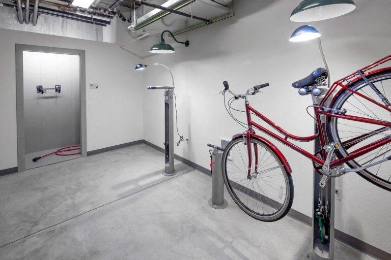 The Wilmore bike locker room with bike hanging