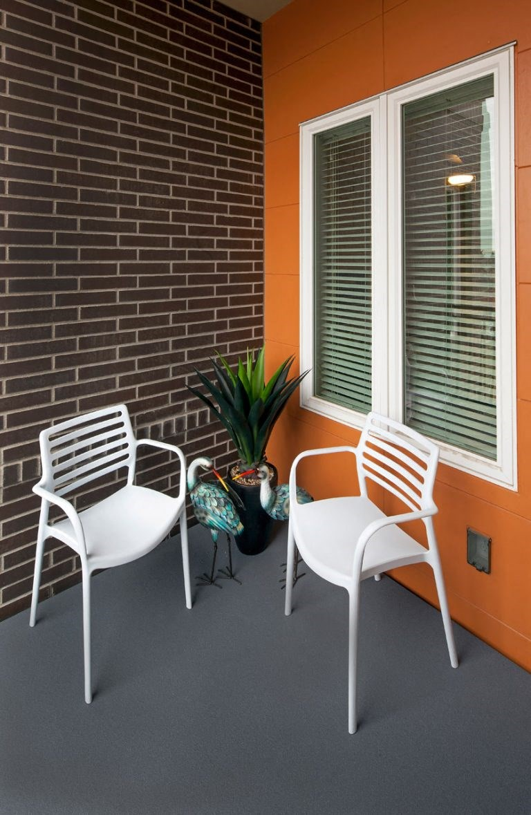 Thh Wilmore patio with two chairs and a plant