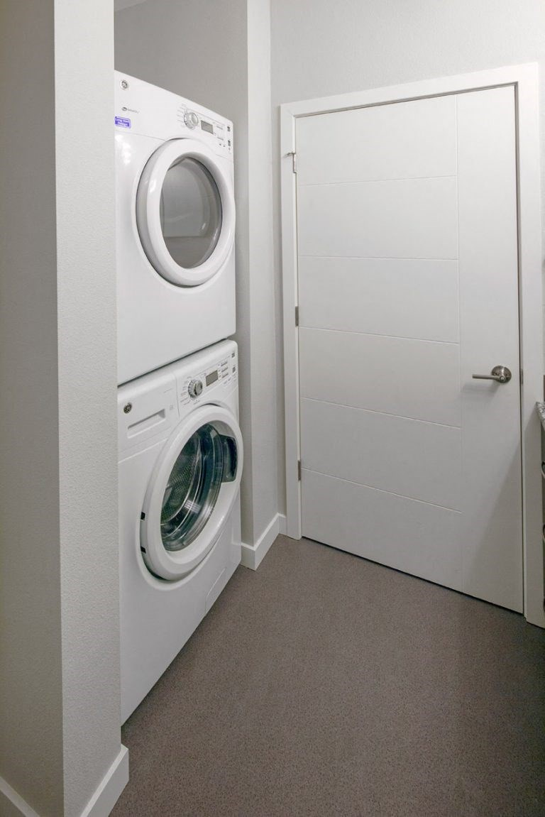 The Wilmore Laundry room with stacked washer and dryer
