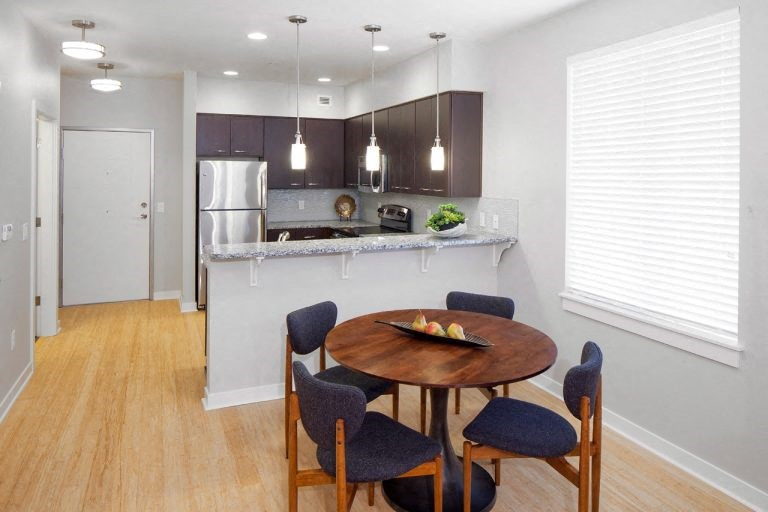 The Wilmore dining room and kitchen with table and chairs