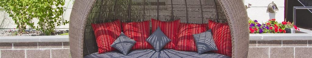 Rooftop Lounge chair with red and gray pillows