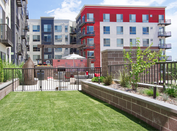 Center courtyard dog park with apartment exterior in the background
