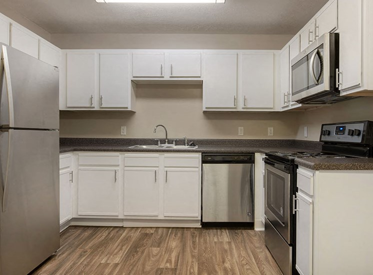 Spacious Kitchen with Pantry Cabinet at Ridgeland Place Apartment Homes, Ridgeland, MS, 39157