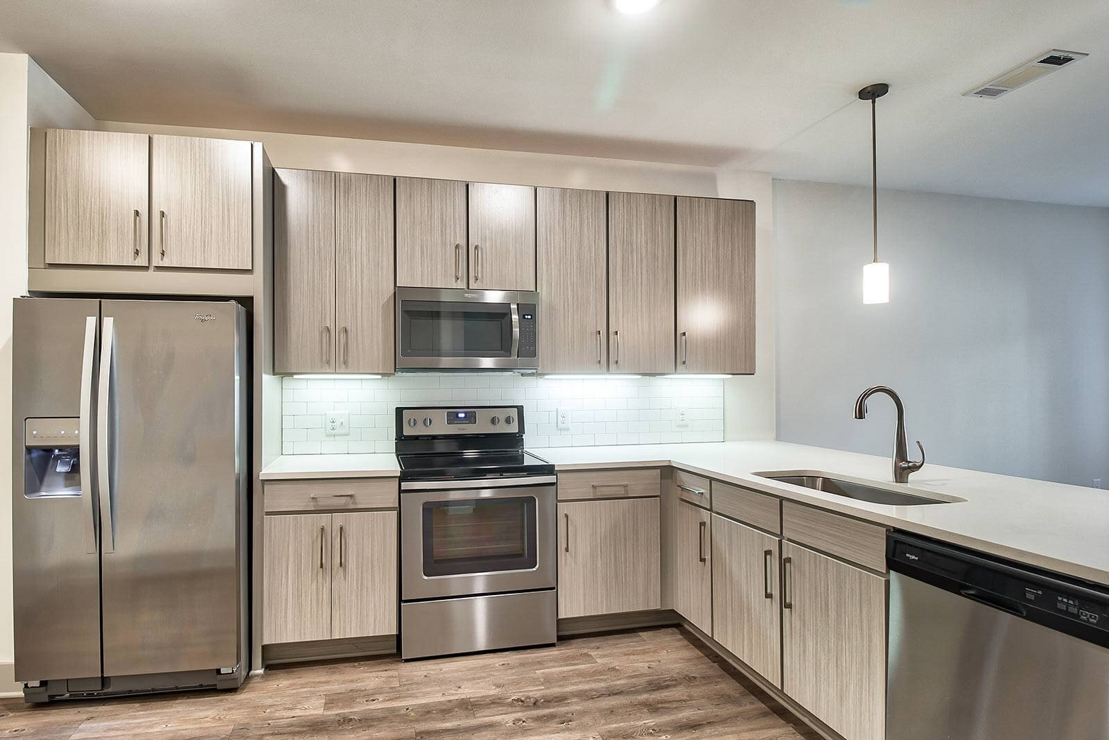 Stainless Steel Appliances and Tile Backsplash in Kitchens at Windsor Parkview, 5070 Peachtree Boulevard, GA