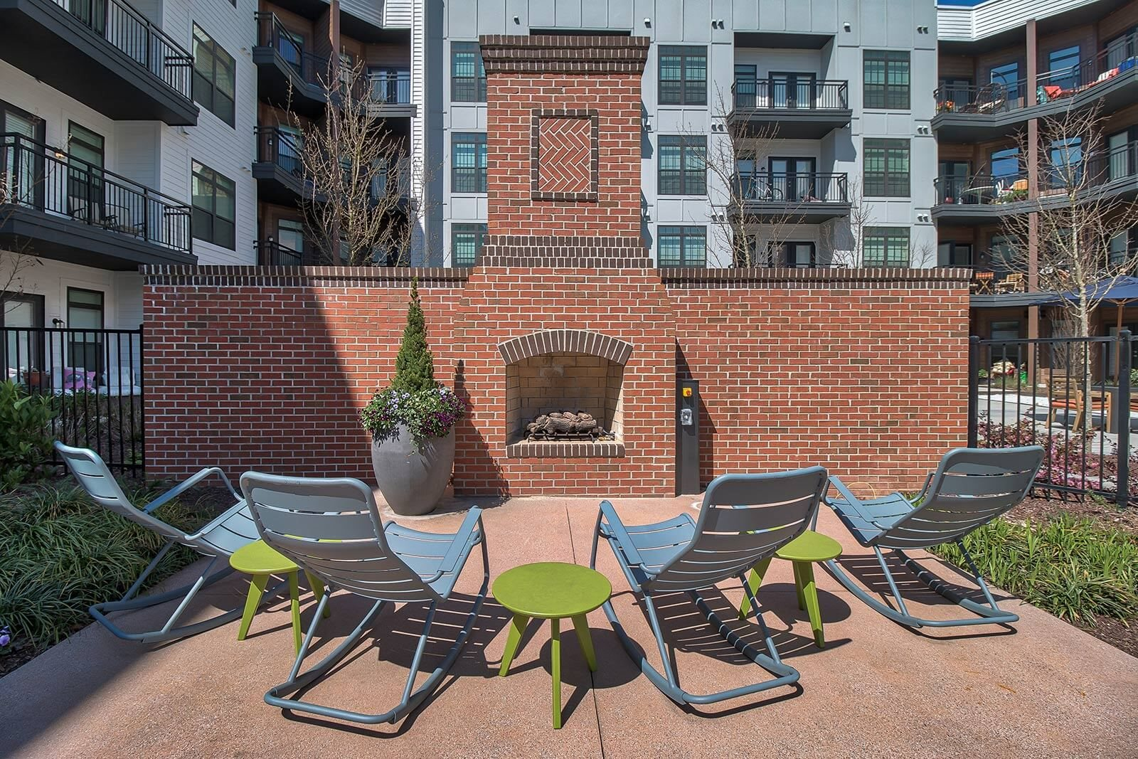 Poolside Fireplace with Lounge Chairs at Windsor Parkview, 5070 Peachtree Boulevard, Chamblee