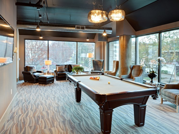 Room with billiards table and TV at St. Mary's Square Apartments, Raleigh, NC